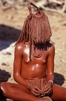 Himba girl wearing puberty veil.