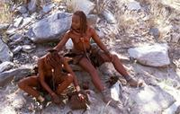 Himba girl anointing her friend
