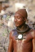 Himba man with conche pendant.