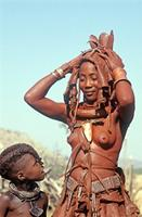 Himba bride with wedding dress, boy looking up at her.