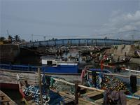 Image of boats and a bridge over the Lagoon in Elmina, Ghana