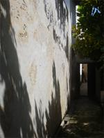 Photograph of the wall and entrance to the garden of Swahili House, Lamu, Kenya