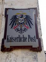 "Photograph of a sign from the ""Kaiserliche Post,"" Lamu Town, Kenya"