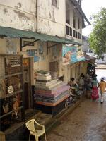 Photograph of shops along the side of the Lamu Fort, Kenya