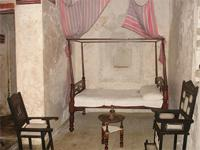 Photograph of a typical bed and chair, Lamu Town, Kenya