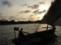 Photograph of a sunset on a boat, Kenya