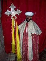 Image of a priest with a cross in Lalibela, Ethiopia