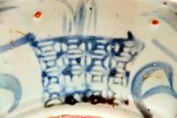 "Indigo blue glaze featuring signs and symbols of ""poetic"" calligraphy on a Chinese porcelain bowl."