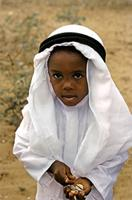 A young visitor to the Maulidi holding cowrie-shells.