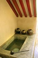 A traditional cistern for storing drinking water in the entrance courtyard of a Lamu house.