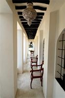 A cool and peaceful veranda that overlooks the garden of the late Bunny Allen's House in Lamu.