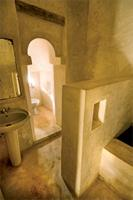 An Islamic arch divides the bathing and toilet facilities in the House of Peace in Lamu.