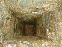 Image of a deep hole in a small room in the northwest ablutions of the Great Mosque in Kilwa Kisiwani, Tanzania