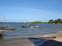 Image of boats at the beach in front of the Gereza in Kilwa Kisiwani, Tanzania