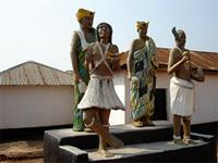 Image of the statues in front of Patakro, Ghana