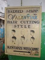 Image of an advertisement for a barber in Lamu Town, Kenya