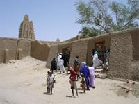 People entering the Djingereyber Mosque in Timbuktu, Mali