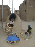 Image of woman baking bread in the morning in Timbuktu, Mali