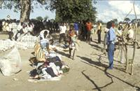 Part 06, Refugees and displaced people, in and around Mozambique: Distribution of clothes to Mozambican refugees in Nyamithutu camp, Malawi, April 1990 [2].