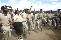 Part 05, ANC members toyi-toyiing at an ANC rally in Lady Frere, Transkei, October 1990.