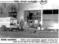 BOMB WARNING ...Police warm bystanders agains coming too close to the scene of last night's blast