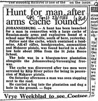 Hunt for man after arms cache found